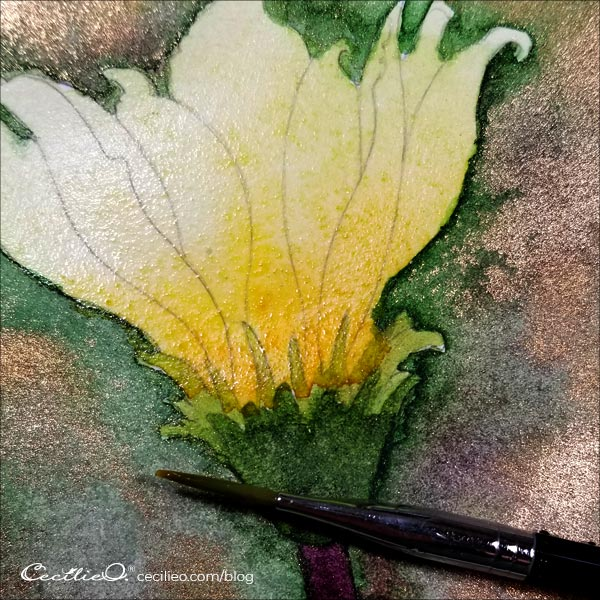 Gently add yellow watercolor to the petals