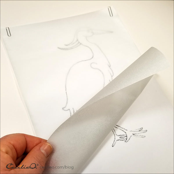 Tracing paper fastened with paper clips.