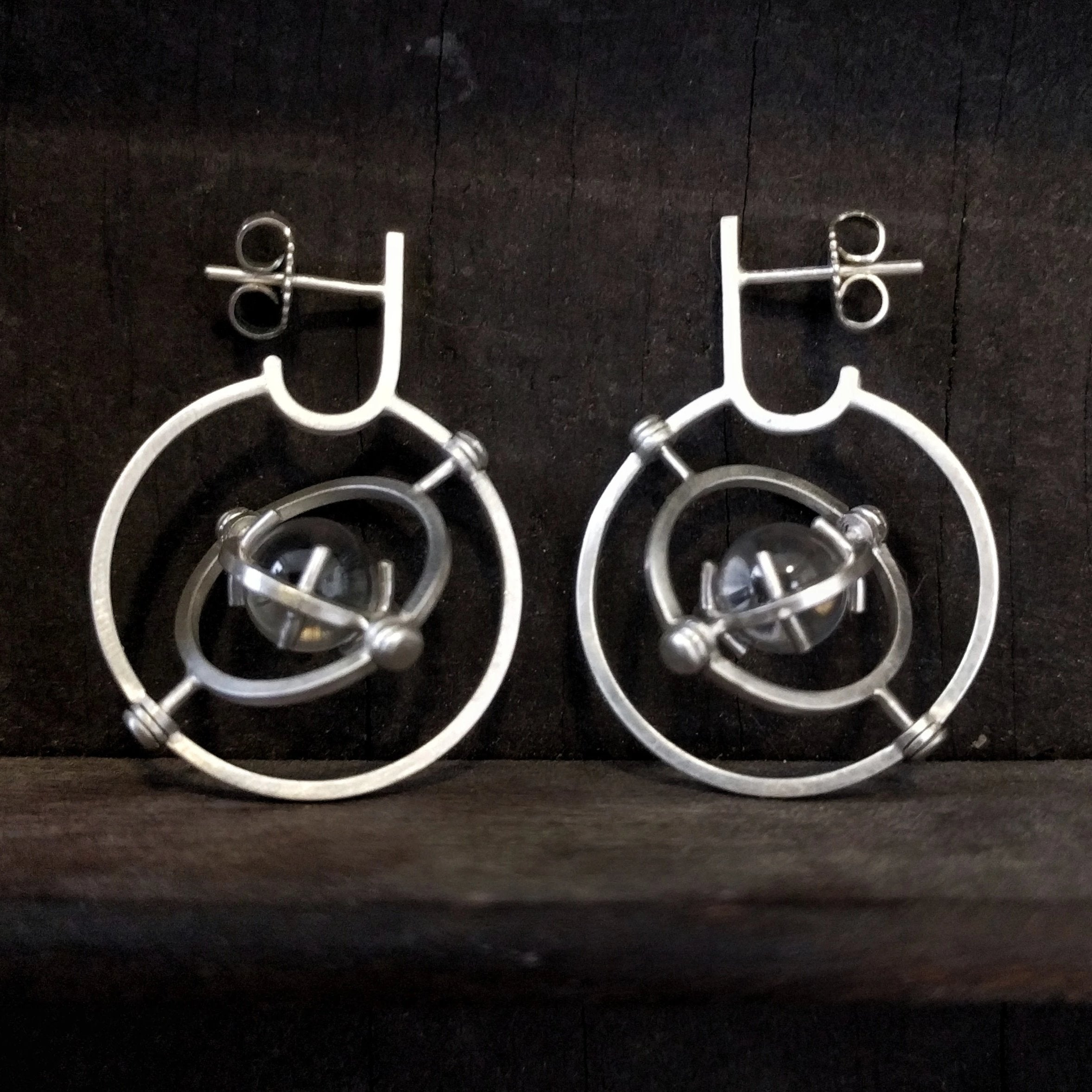 turning futuristic steampunk earrings