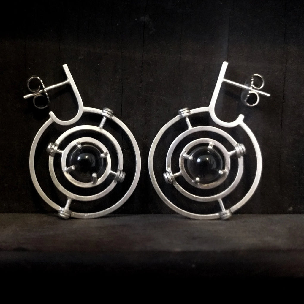 Kinetic planetary hoop earrings