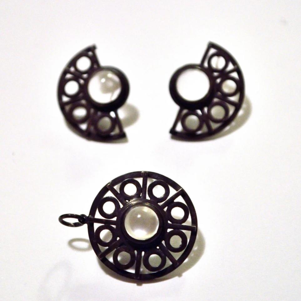 geometric ironwork pendant and earrings