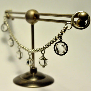 Caged Sphere Quartz Charm Bracelet