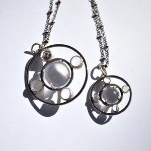porthole art deco pendants