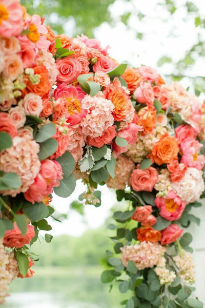 living coral flower wedding ceremony arch