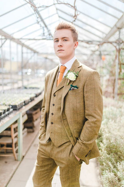 botanical greenhouse wedding style groom