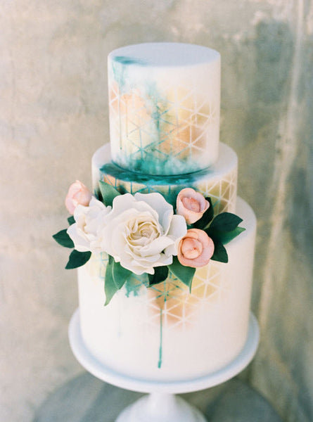 metallic wedding cakes desert style geometric rose gold