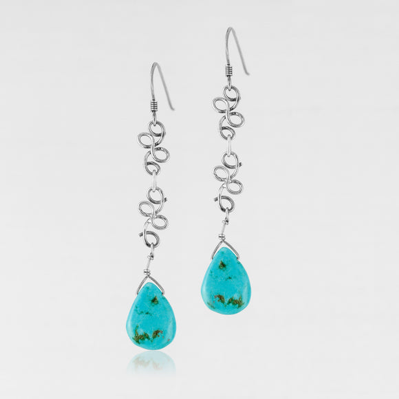 Sterling silver genuine teardrop cut turquoise handcrafted earrings.