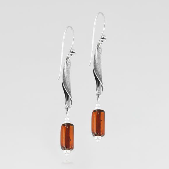 Sterling silver flow  juxtaposed with natural amber, handcrafted earrings
