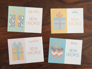 personalised gift cards with wrapped gifts in pastel colours