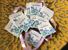 purple flowers gift labels in a yellow wooden bowl
