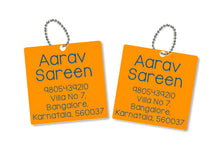 metallic bag tags  in orange with personalised information