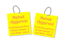 metallic bag tags  in yellow with personalised information