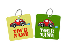 pair of square metal bag tags in green with red car