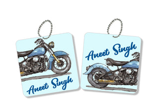 A pair of metal bag tags with a motorcycle image labelshabel