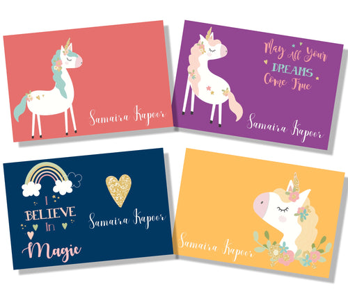 set of gift cards with unicorns and rainbows in floral wreaths in peach, purple, yellow and blue