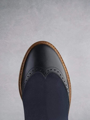 Abril - our brogue detailed Chelsea boot in navy leather and suede.