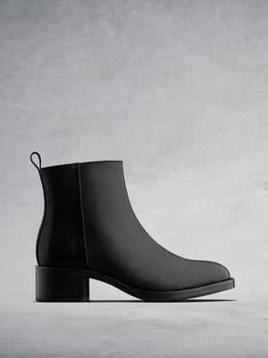 Arietty, a timeless black leather ankle boot with a classic silhouette.