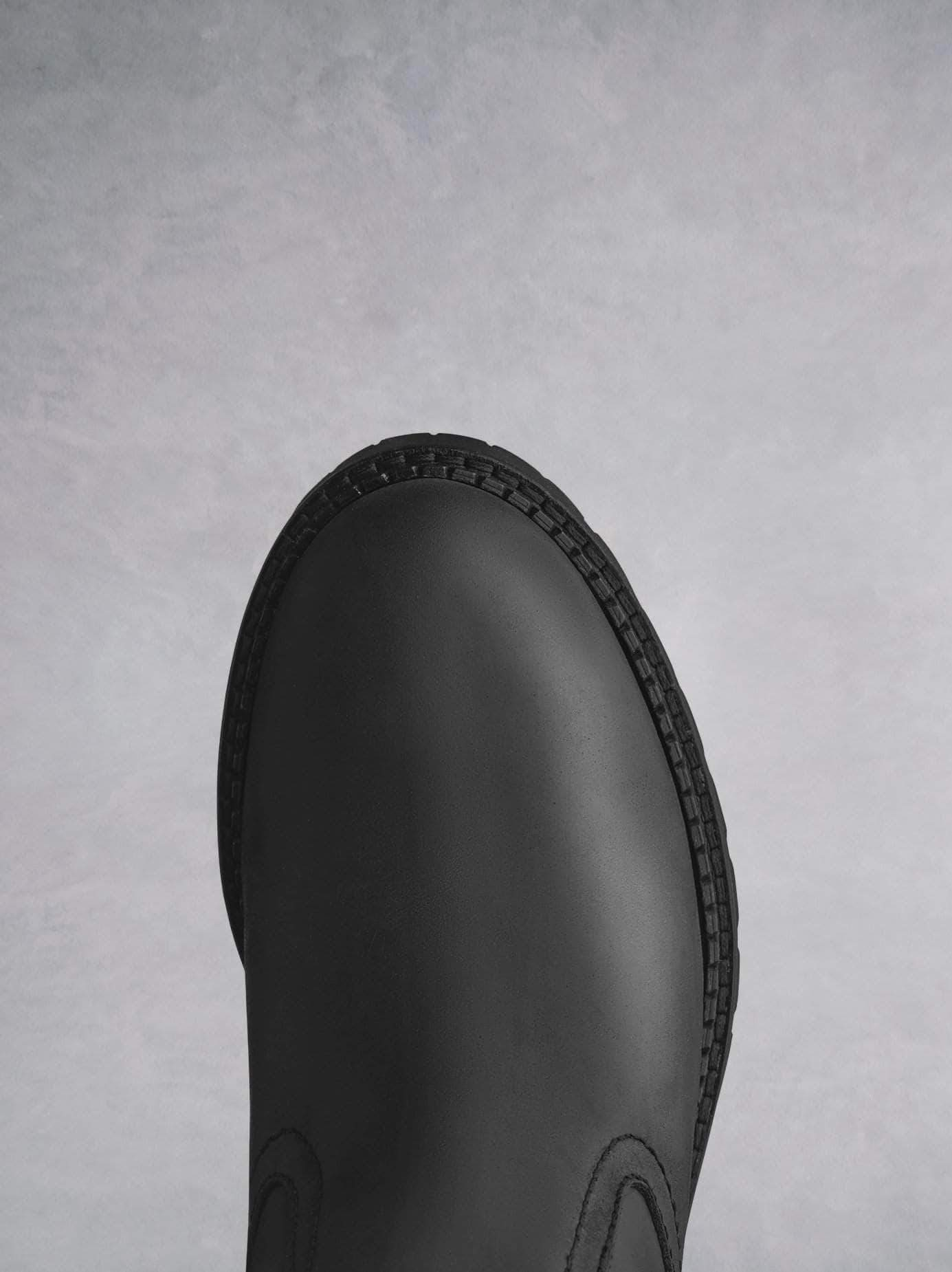 Asham Black Leather - Glossy black leather boots with tread sole.