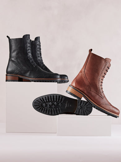 Black leather ankle boots with brogue detailing and a leather trim around the fashionable rubber tread sole.
