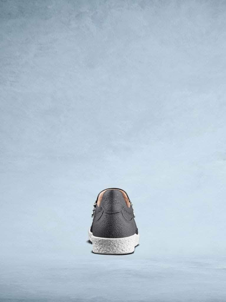 This stylish slate grey leather trainer has a simple, easy to wear design.