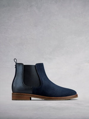 The Darwin, a versatile navy suede Chelsea ankle boot with an edge.