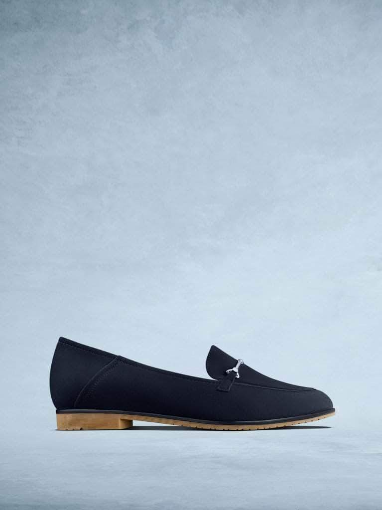 Fistral is our elegant navy suede pump with silver bar detailing.