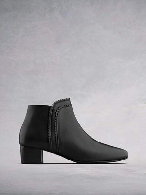 Florencia, our black leather ankle boot with a scalloped edged trim.
