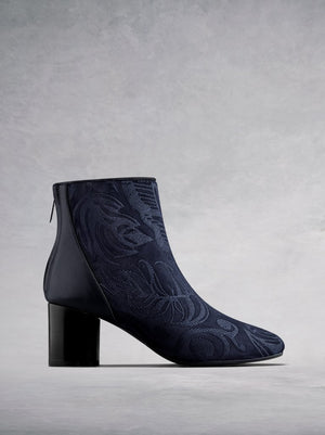 The Gosford, an embroidered navy suede and leather ankle boot.