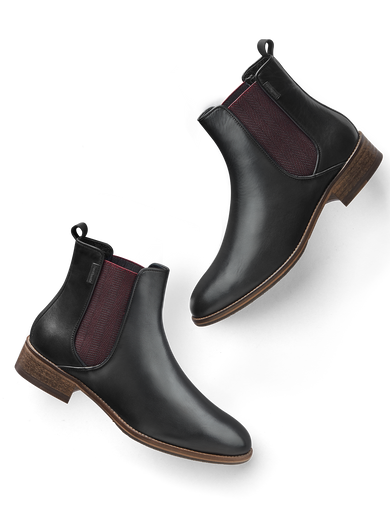 Grove in black leather, with a contrasting burgundy herringbone elastic panel.