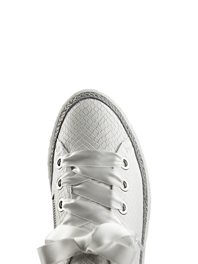Harlyn, featuring interchangeable white ribbon and cotton laces to suit you.