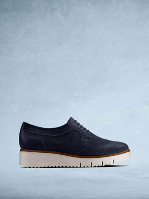Helston - our metallic navy leather platform trainer with brogue detailing.