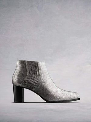 Miller, our metallic silver leather ankle boot is a modern take on the classic Chelsea boot. Available in standard or wide fit.