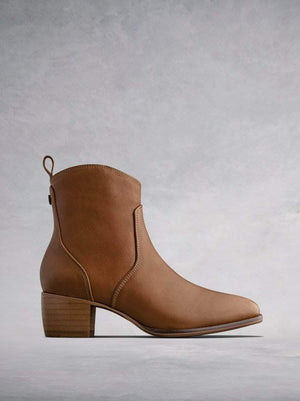 The Paxton, an artisan tan leather, western-inspired ankle boot.