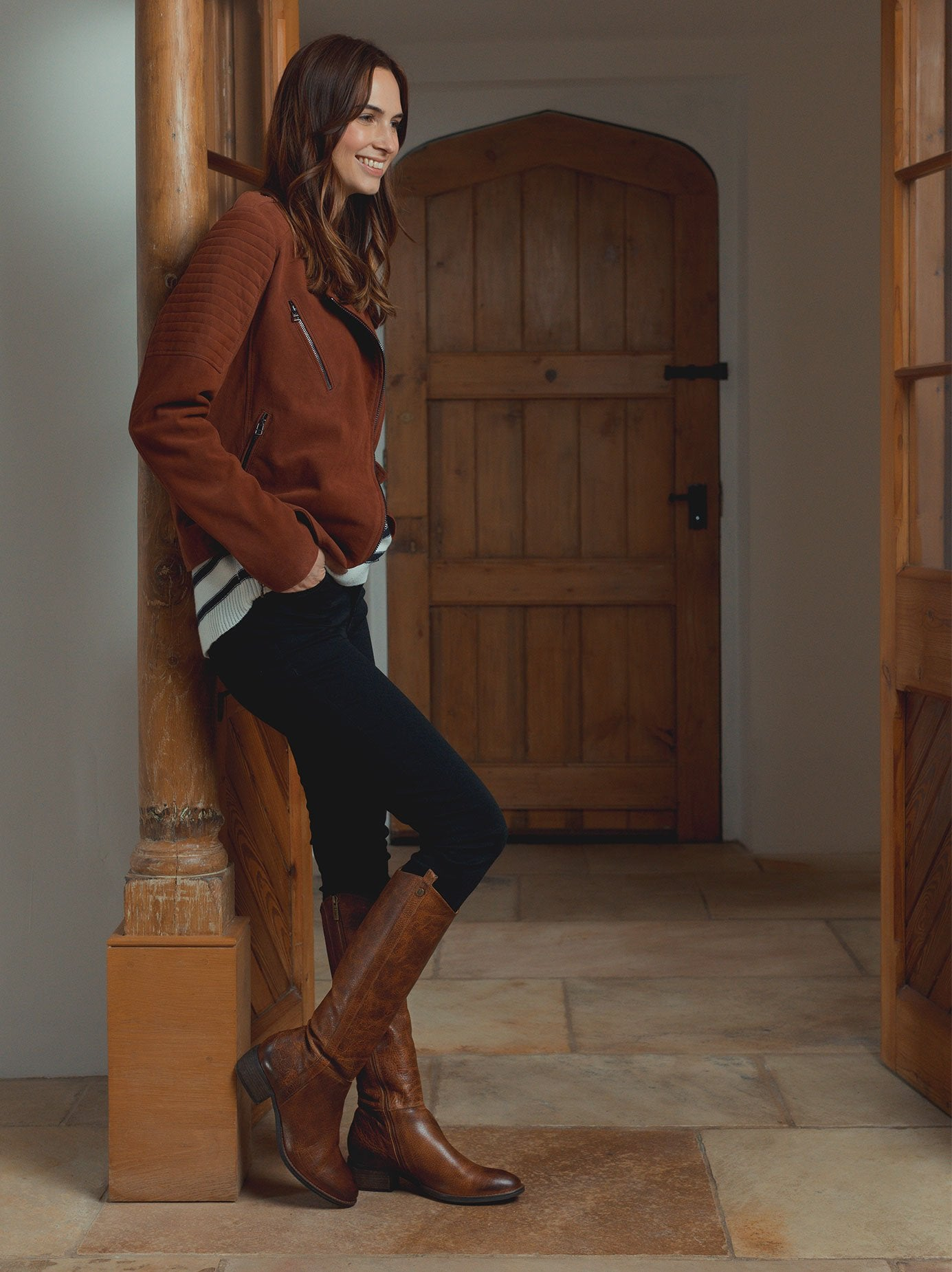 The staple tan boot has a curved topline - both stylish and practical.