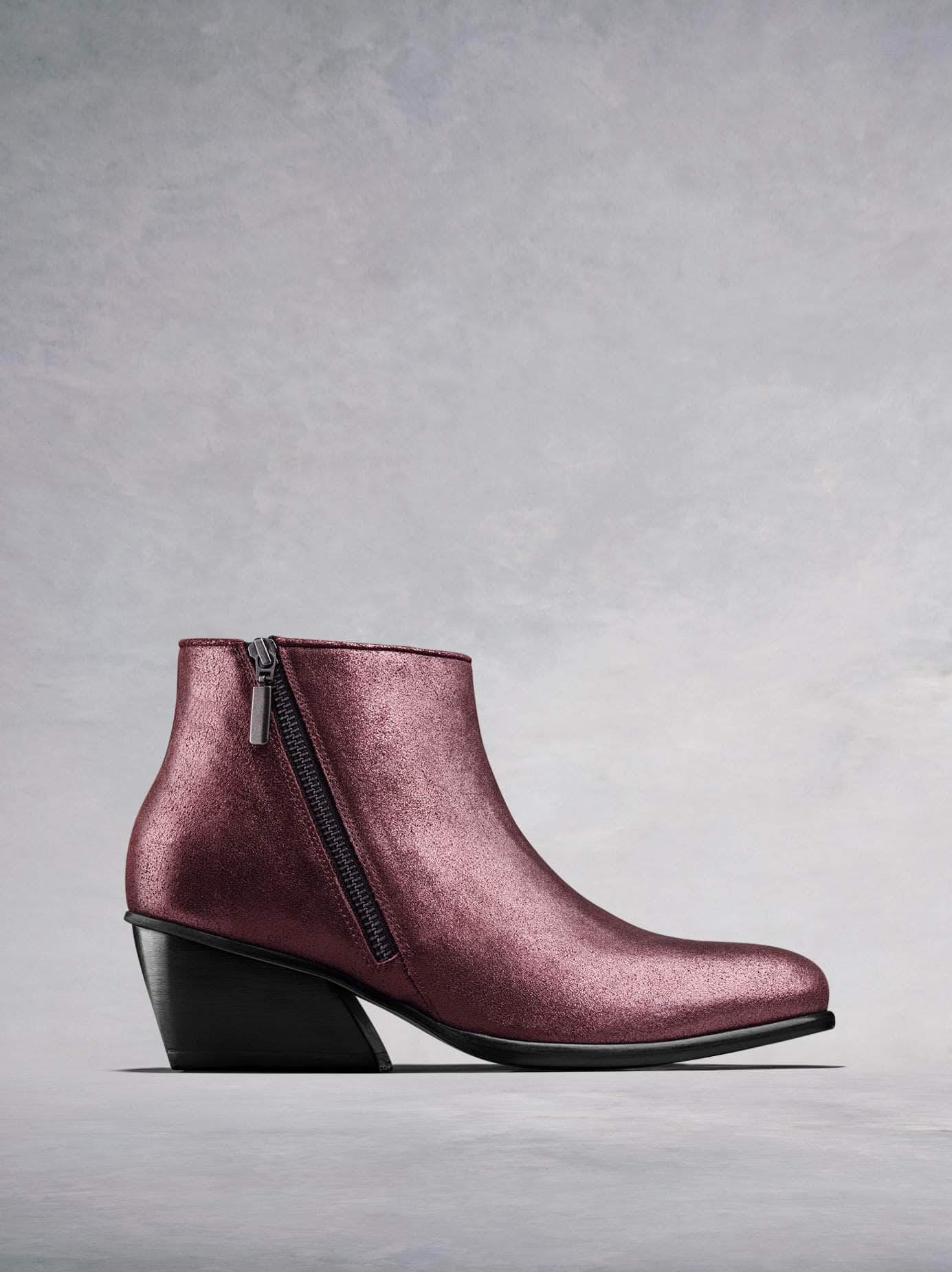 Renata, our on-trend ankle boot with angular heel and diagonal zip in plum metallic leather. Stand-out style. Available in our standard or wide fit.