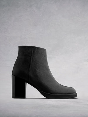 The Ryton - a high heeled ankle boot in black lizard embossed leather.