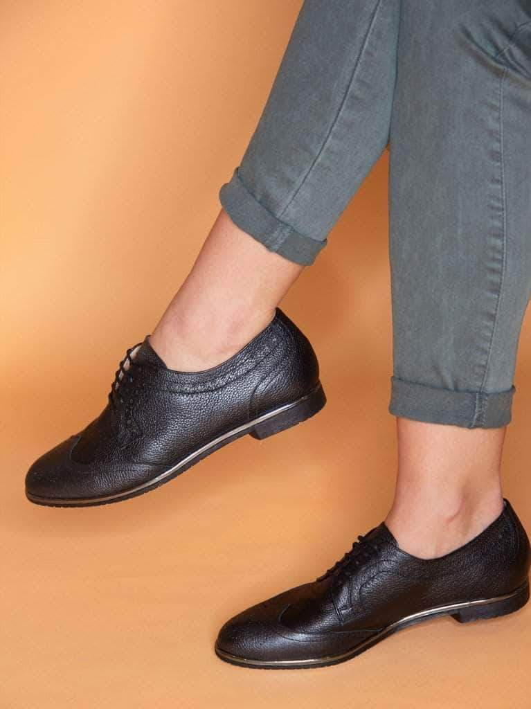 This formal black brogue shoe has a contrast gun metal trim around the sole.