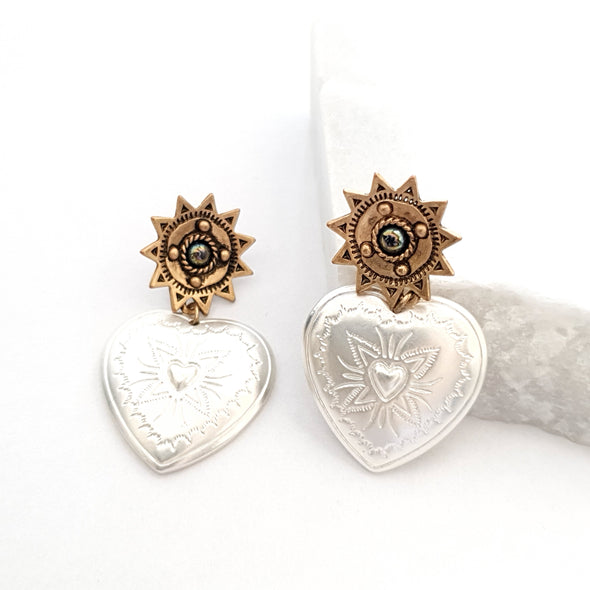 Earrings with heart pendant