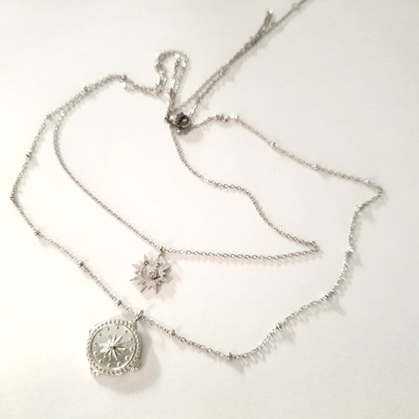 Necklace with compass and star charm