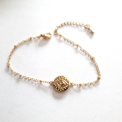 Bracelet with coin eye