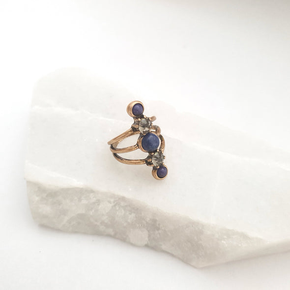 Ring with dark blue stones