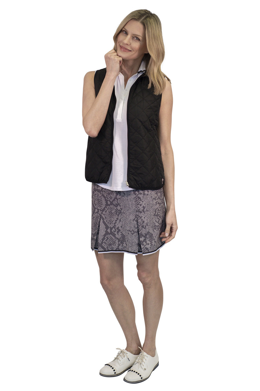 women's grey snakeskin designer golf skort with black and white trim. Black and white reversible women's vest.
