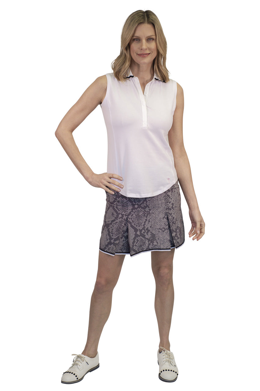 grey snakeskin designer golf skort with black and white trim. Women's white sleeveless designer golf polo