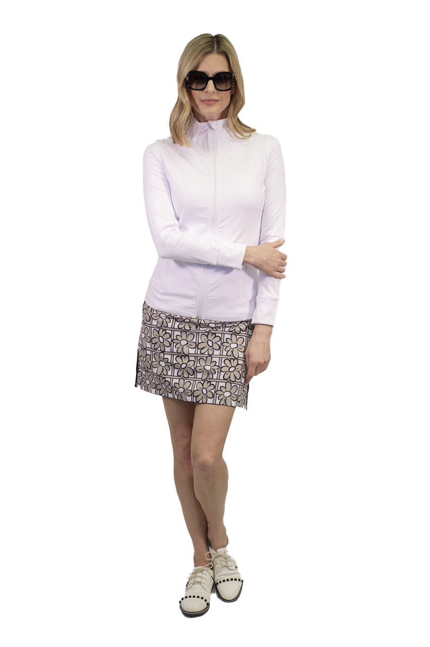 Khaki white and black floral women's golf skort. Stretch performance ladies skirt also available in a longer length. Women's white jacket.