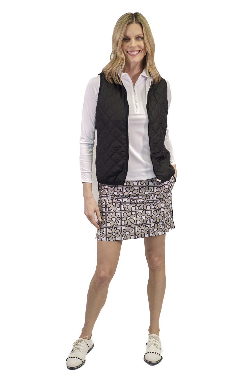 Khaki white and black floral women's golf skort. Stretch performance ladies skirt also available in a longer length. Black and white reversible vest for ladies golf.