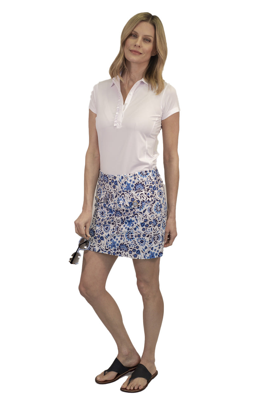 women's blue and white floral designer golf skort. Comes in 2 different lengths for a longer option. Women's white short sleeve ruffle golf polo