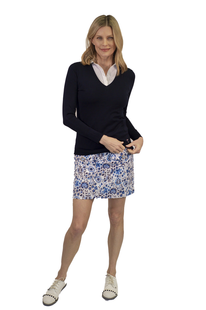 women's blue and white floral designer golf skort. Comes in 2 different lengths for a longer option. Women's navy v-neck sweater.