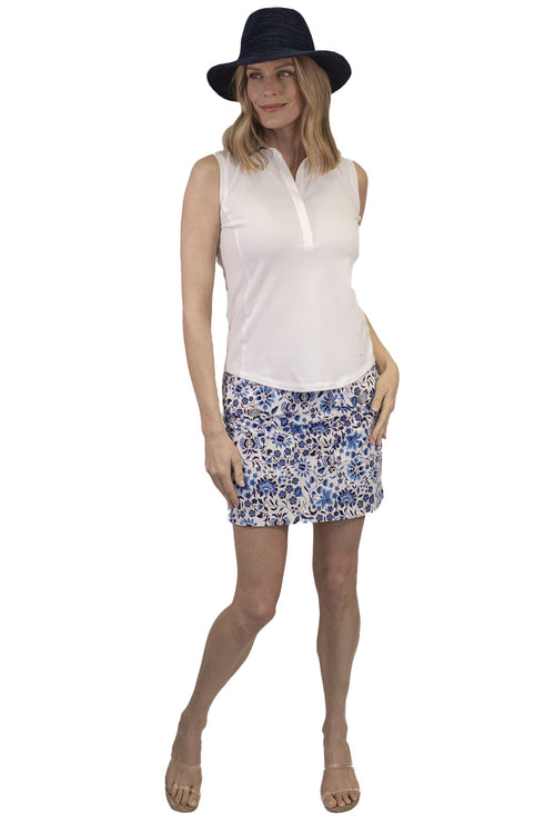women's blue and white floral designer golf skort. Comes in 2 different lengths for a longer option. Women's white sleeveless golf polo