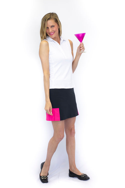 Women's black and hot pink pull-on golf skort. Ladies designer golf apparel. Fashionable golf skirts