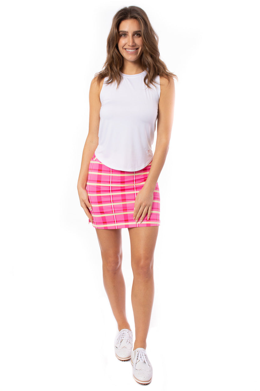 hot pink light pink yellow and white pull on designer golf skort with a hot pink sleeveless golf polo